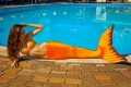 Хвост русалки оранжевого  цвета